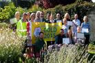 Calne in Bloom won a gold award.  Co-ordinator Trudy King (centre left) is pictured with members of It's Your Neighbourhood, Page Close, Friends of Abberd Brook, Castlefield Canal and River Park, Holy Trinity Church Yard, Calne Town Council ground staff,
