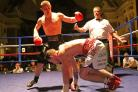 Joe Hughes has opponent Anthony Upton in trouble during their fight in Walsall last night. Picture: ROBERT ELLIS