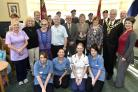 Staff from the care home, Bath and West Wilts Branch of the Royal Engineers  with L-R Middle Row (Light blue shirt) Ray Horan Activity Organiser, Family members Adrian Godwin and Sandra Clifford holding the Medal, Tracy Williams Home Manager, Mayor Roger