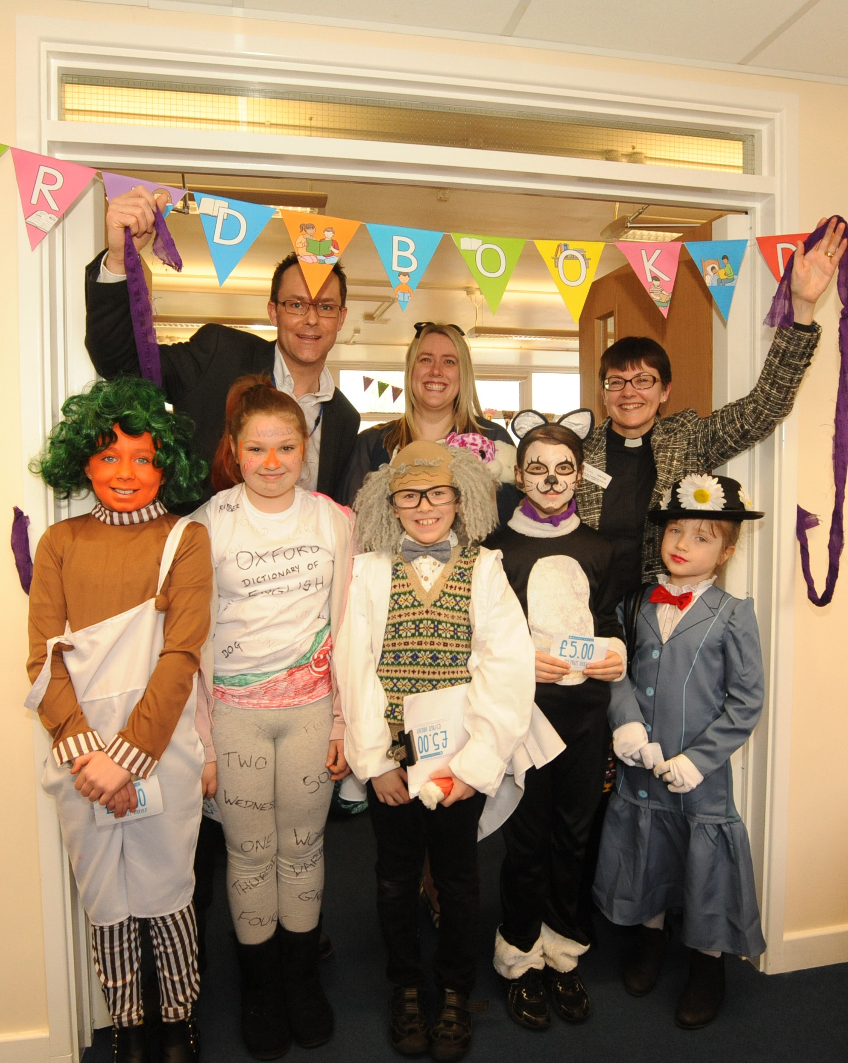 World Book day. Arch Deacon Sue Groom  who cut the ribbon to open the new library at Southbroom St James  academy at Devizes  along with head Nigel Andrews ,  Sarah Byford and voucher winners all dressed as there favourite book character to coincide with