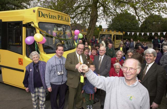 Devizes PHAB Club chairman Brian Lyons, with the key to the new minibus with MP Michael Ancram in 2001