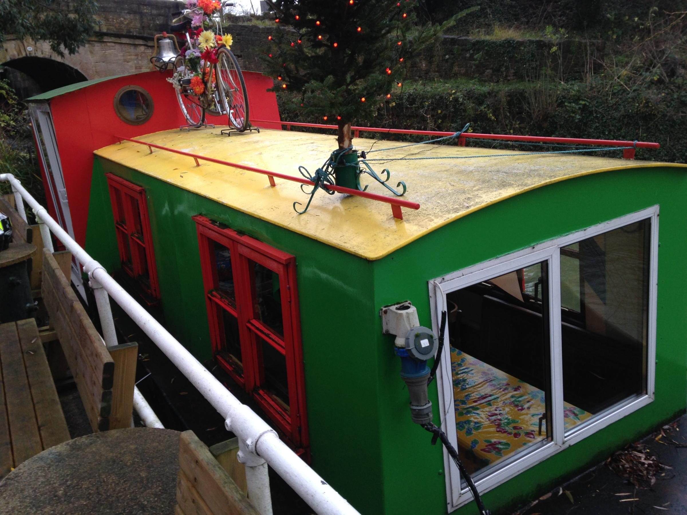 A canal boat which has been transformed into seating at the Lock Inn Café