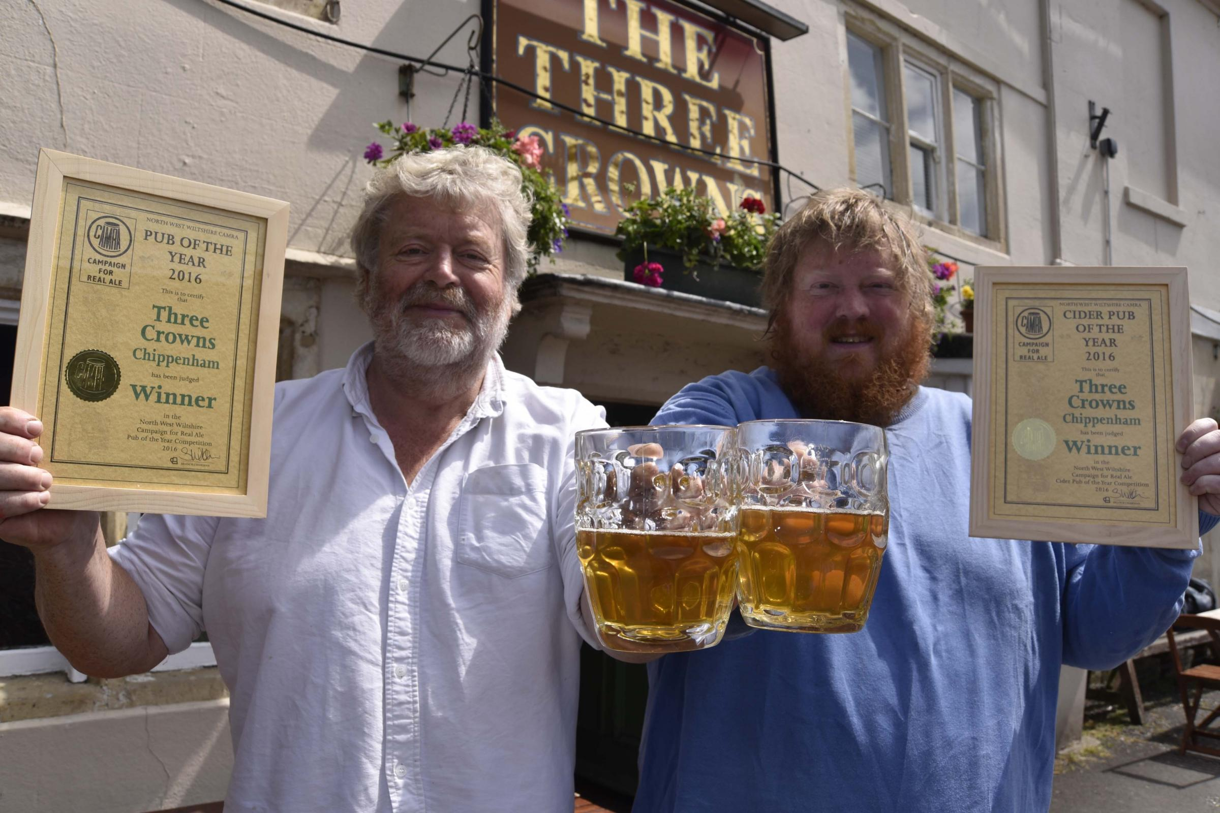 Steve Jenner and his son Tom, of the Three Crowns pub, Chippenham, with their two awards from CAMRA. Glenn Phillips  GP376-3.