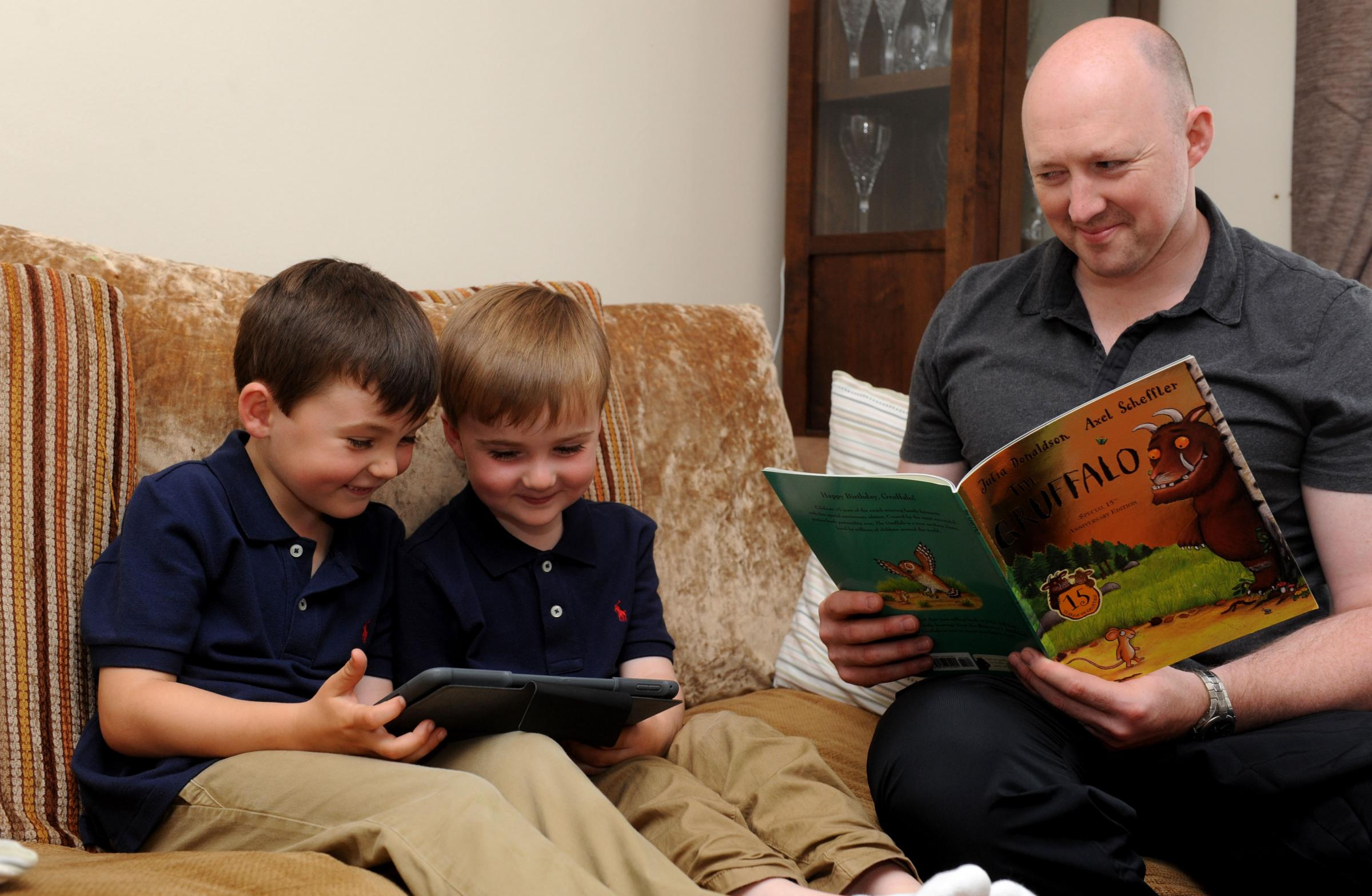 father reads a bedtime story