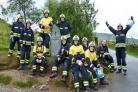 The Corsham firefighters at the start of their Snowdon climb last year.