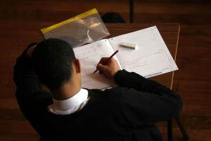 A teenager taking a maths exam. Picture: David Davies/PA Wire