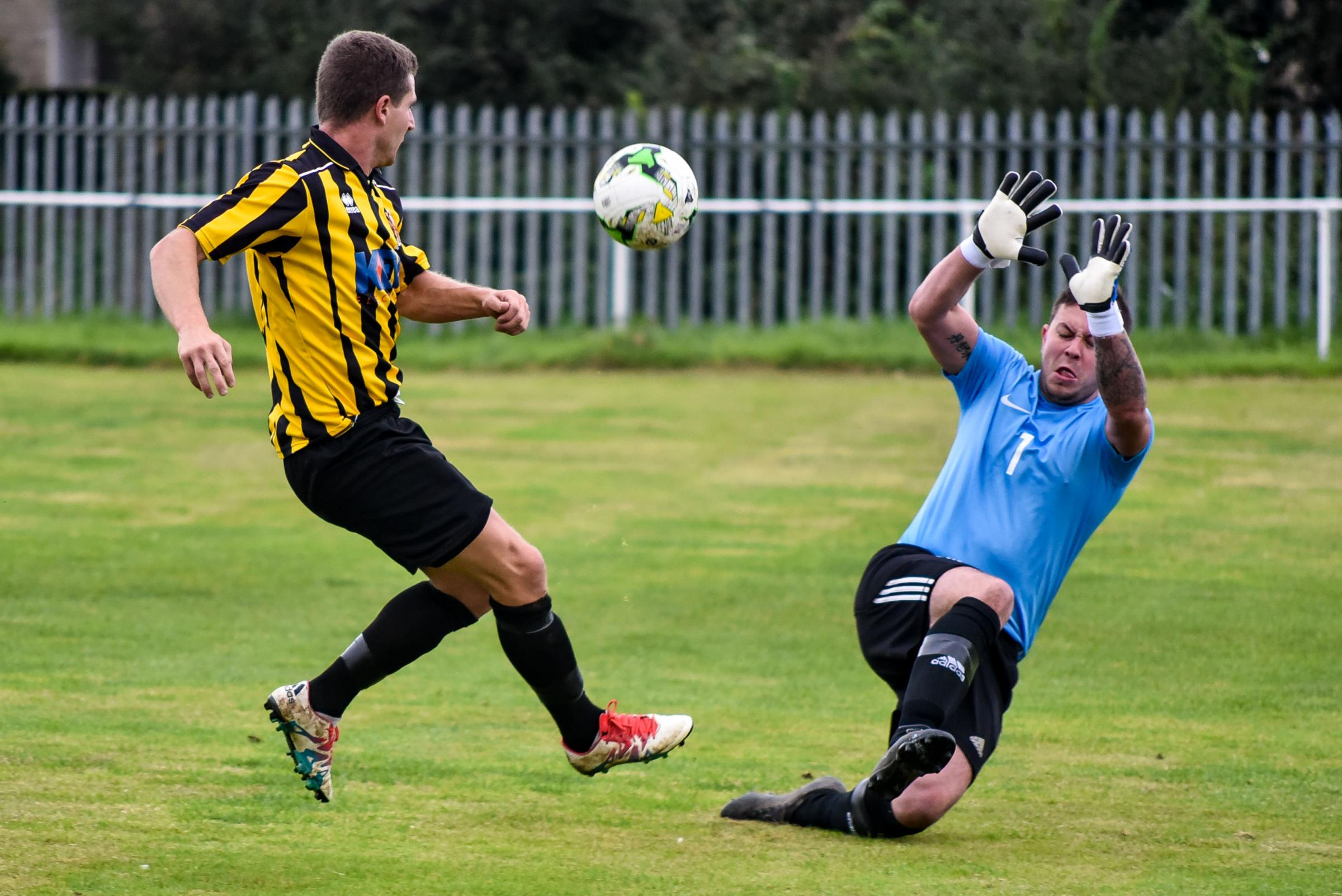 Trowbridge's Millard chips over the keeper to equalise during Saturday's county cup tie