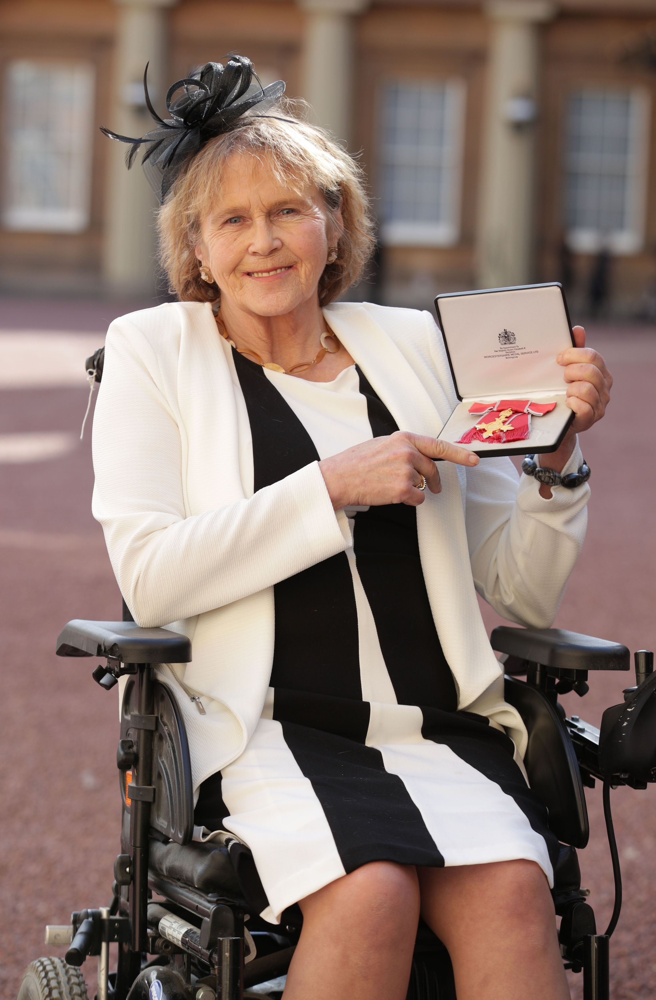 Anne Dunham, pictured after receiving her OBE from the Queen at Bucingham Palace last week