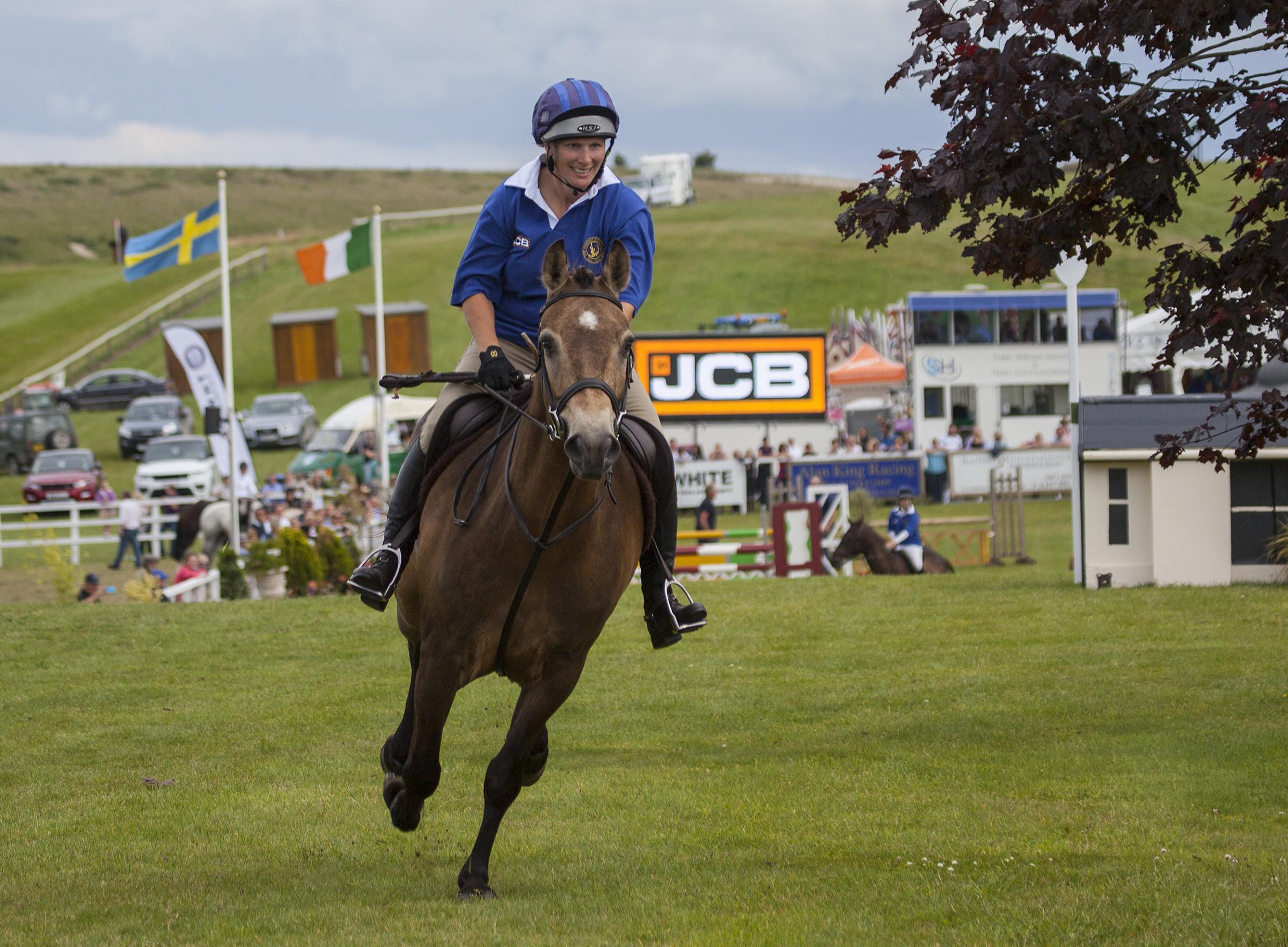Zara Tindall captains the Event riders in the JCB Champions Challenge at Barbury