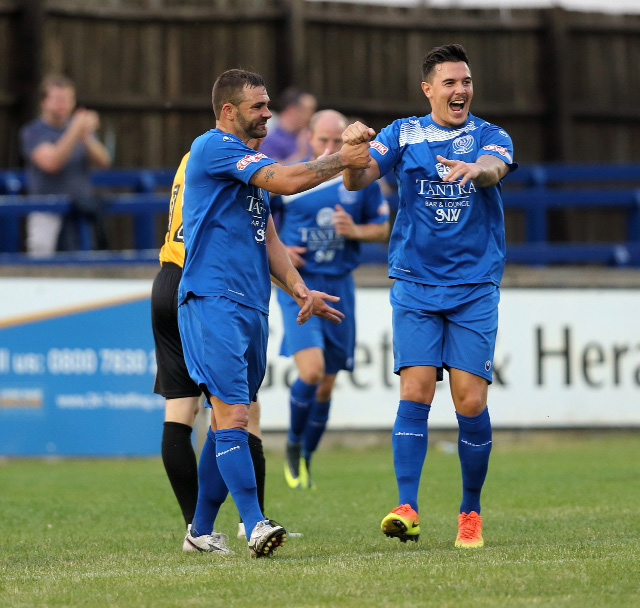 Andy Sandell (left) is congratulated after scoring Chippenham's goal against his former club Newport County Picture: CHIPPENHAM TOWN FC
