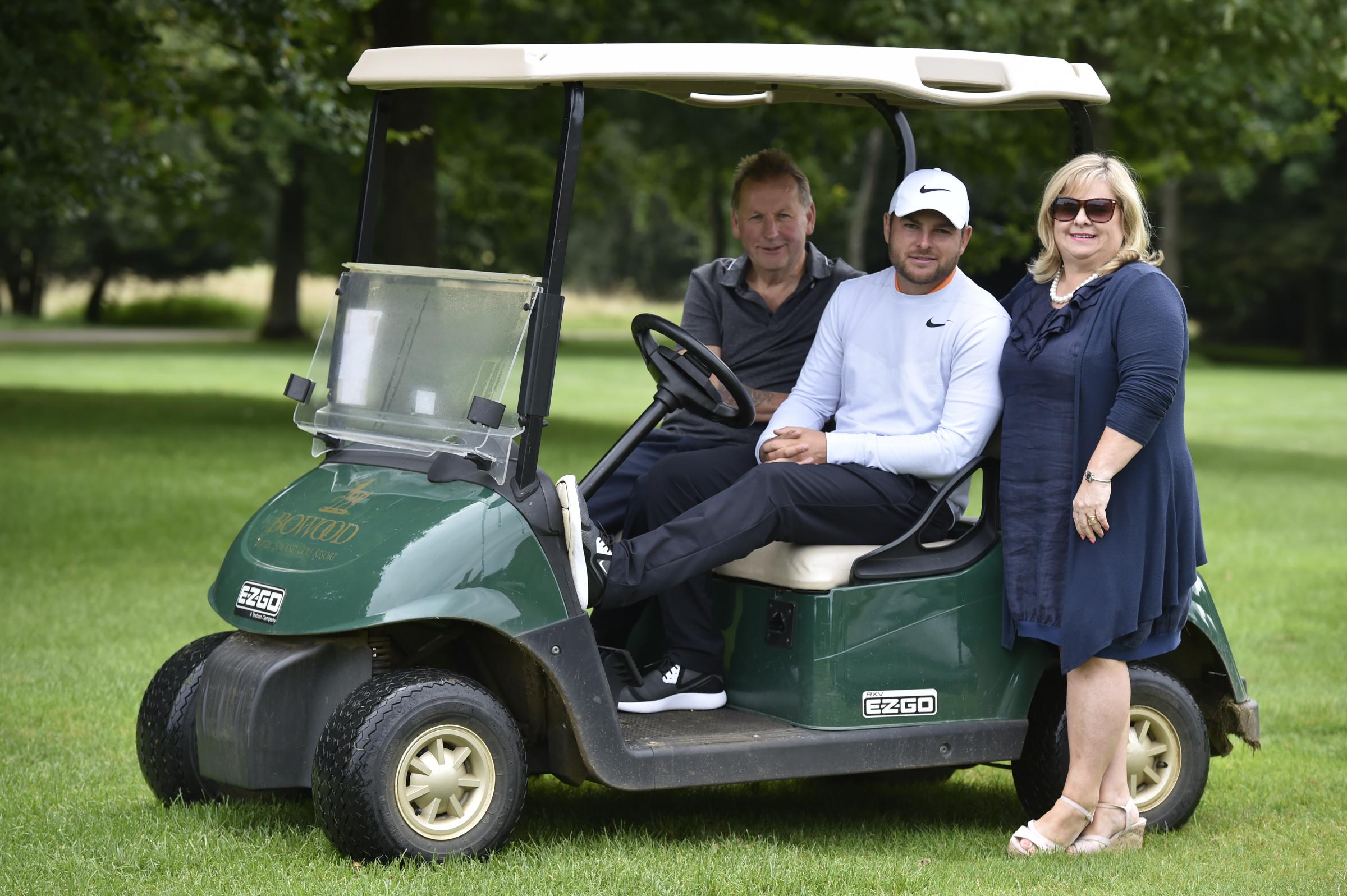 Jordan Smith (centre) with dad Martin and mum Emma Smith at Bowood Golf Club, following his top-10 finish at the US PGA Championship - his first-ever appearance in one of golf's four major championships