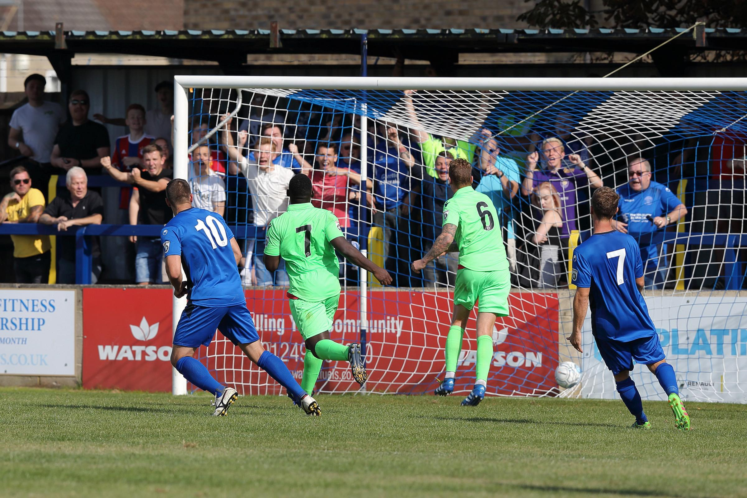 Andy Sandell (10) scores Chippenham Town's third against Oxford City this afternoon (Picture: RICHARD CHAPPELL)