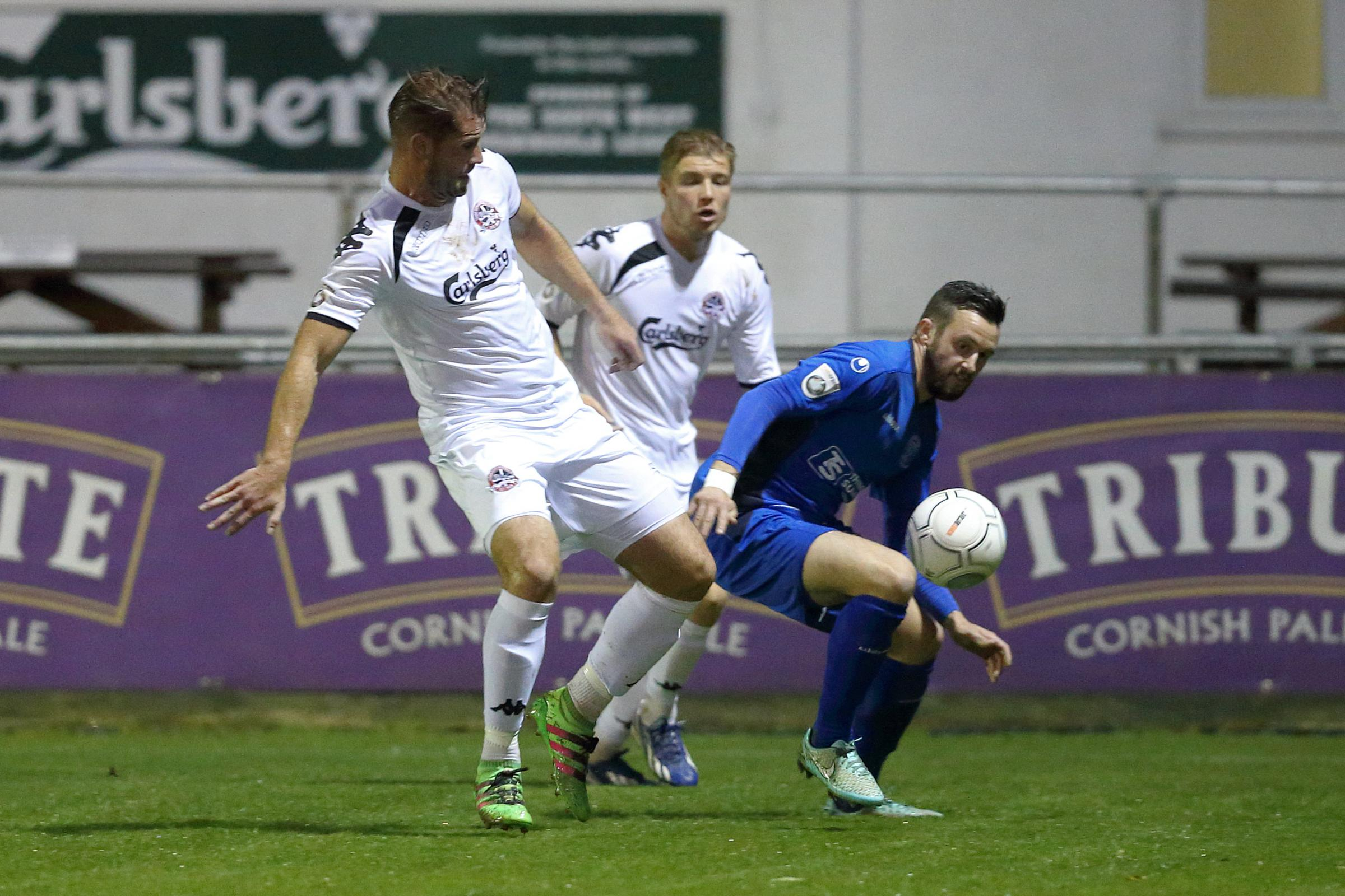 Matt Smith (blue) in action for Chippenham Town at Truro City. PICTURE: RICHARD CHAPPELL