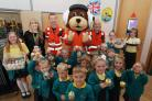 Group photowith children and L-R Kenreas Stratford, Craig Wilkins and Steve Riddle from WAA. Photo: Vicky Scipio VS2591/2..Children at Trinity Primary School in Devizes have baked cakes and having a cake sale with Wiltshire Air Ambulance to raise money. S