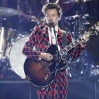 The Wiltshire Gazette and Herald: Harry Styles divides fans with bright and bold suit for solo performance (John Salangsang/AP/PA)