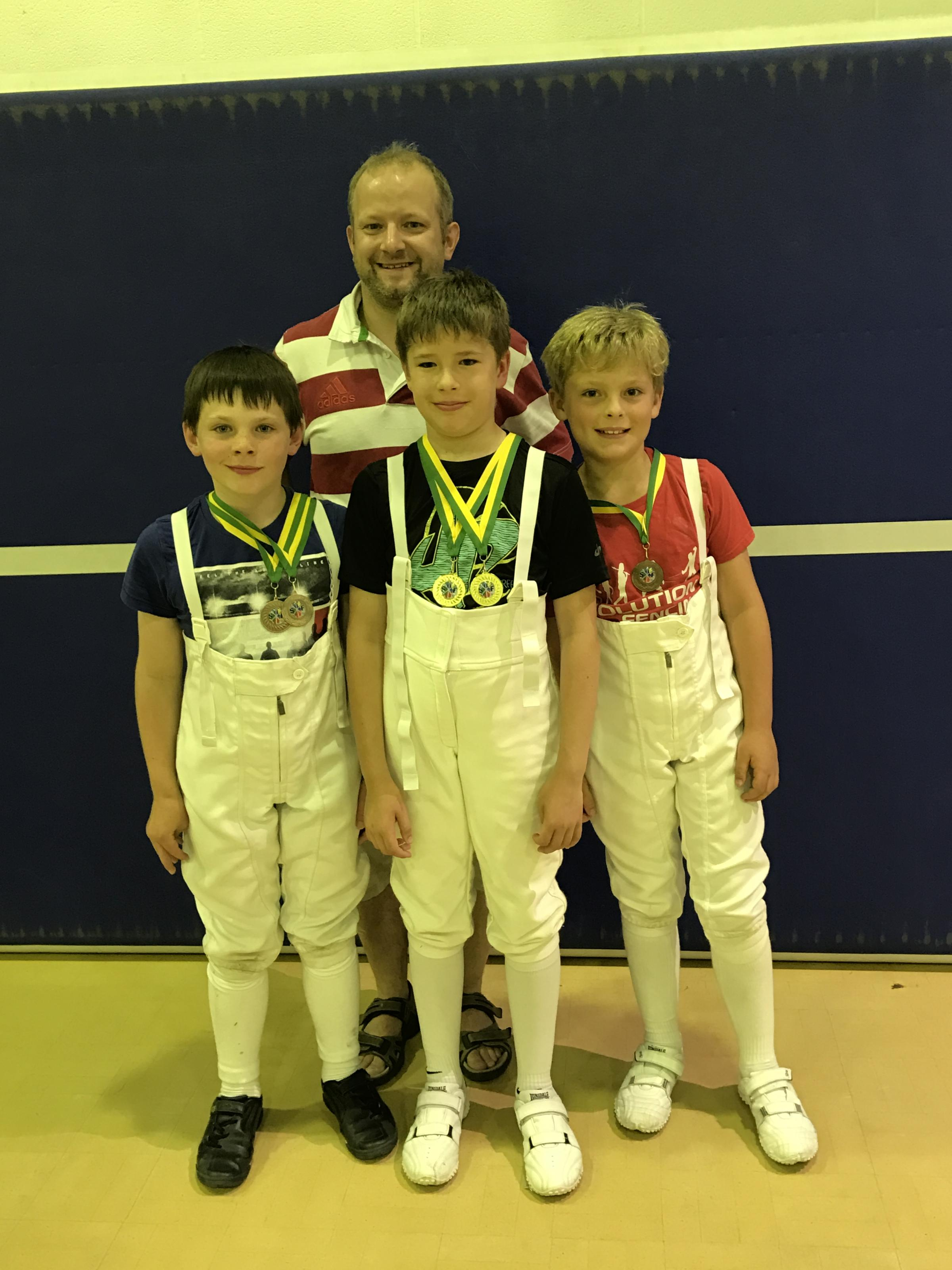 Rohan MacDonald (centre) with Jacob Dawson (left), Oliver Brookes and coach Neil Bromley