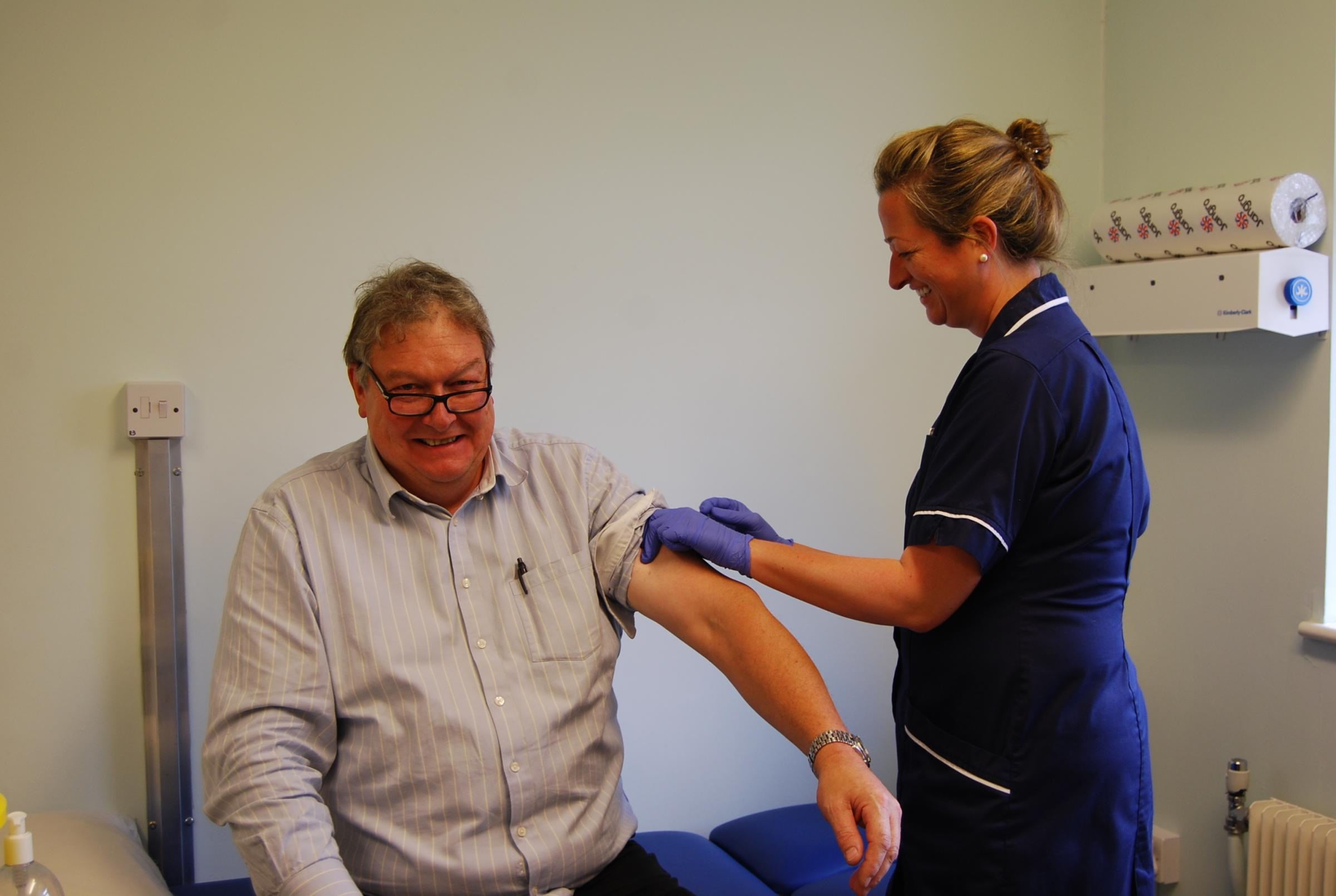 Dr Toby Davies being given the winter flu vaccination