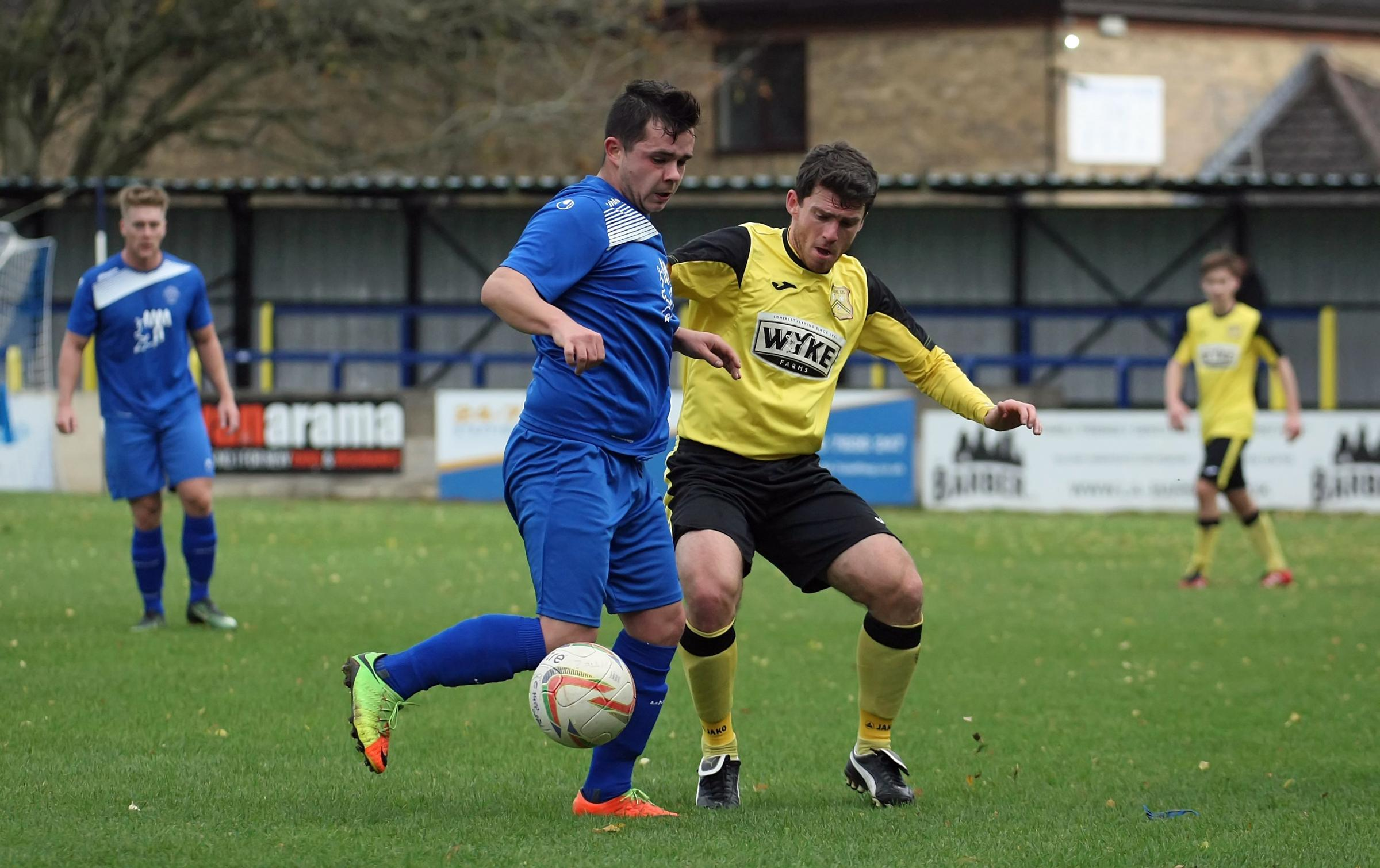 Action from the clash between Chippenham Park (blue) and Cheddar at the weekend