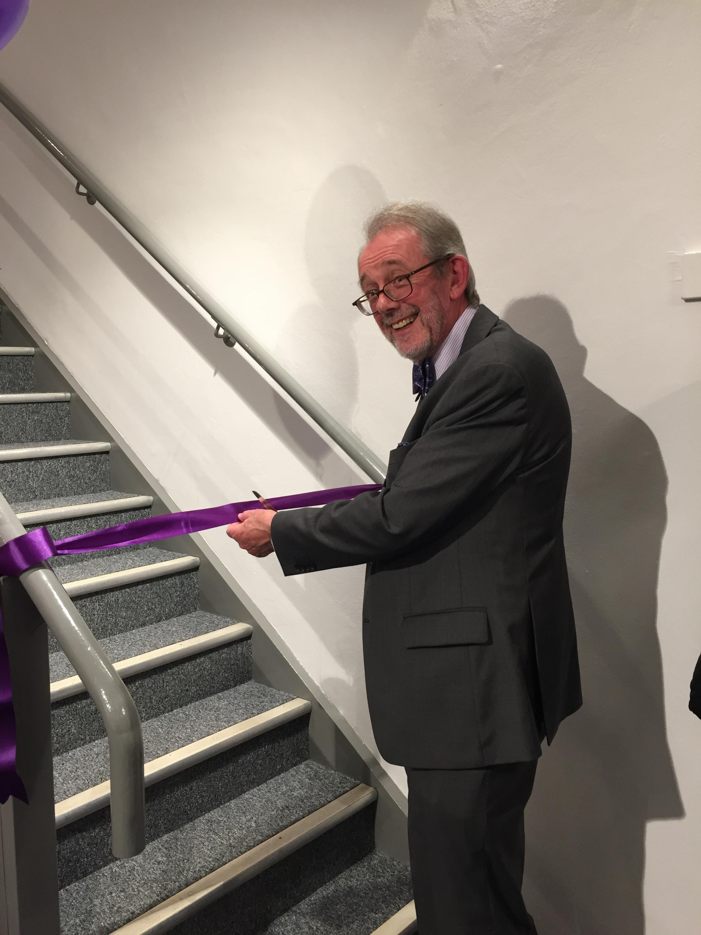 Deputy Mayor Andy Geddes cuts the ribbon to open the revamped Wharf Theatre