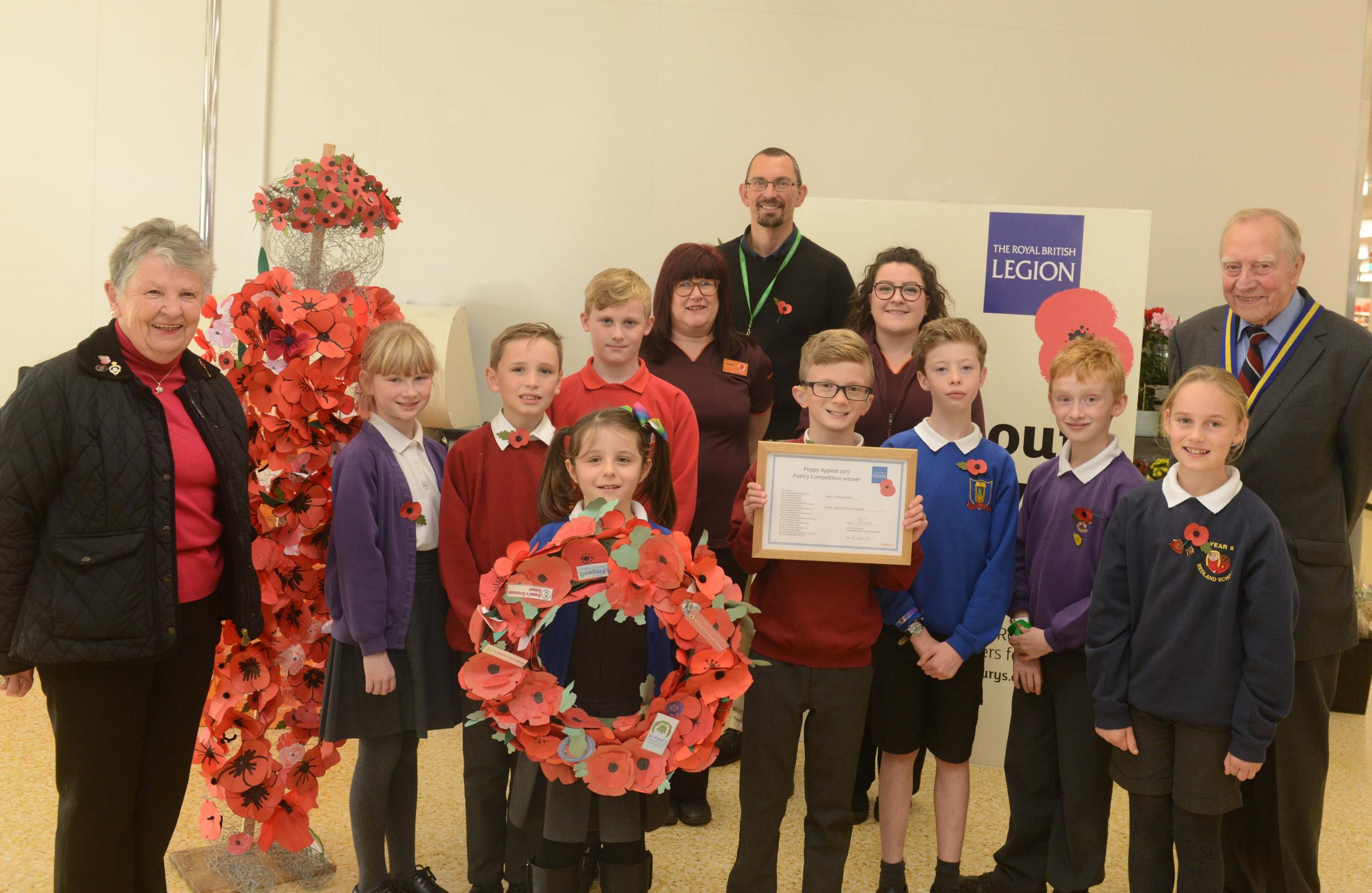 Calan Gilmour (front centre), winner of Remembrance Sunday poetry competition with adults l-r Irene Sinclair, Michelle Perry, Andrew Skelton, Rochelle Oliver and Jim Scott. Photo: Siobhan Boyle SMB2210/1.
