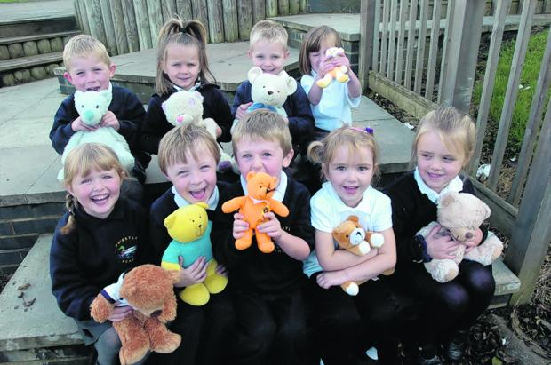 Priestley reception class pupils have a giggle while Abi, left, gives her teddy a lift