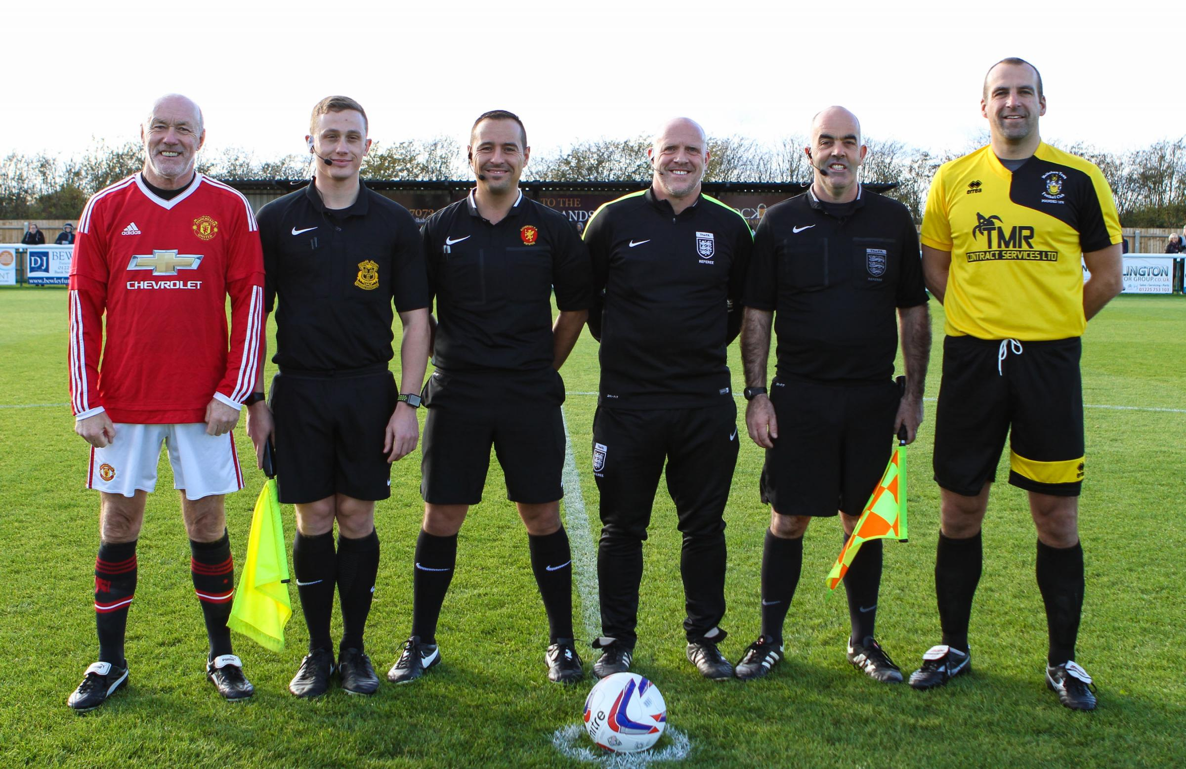 Manchester United's Sammy McIlroy and the Select XI's Matthew Bond , with the match officials before Sunday's match (Pictures: JOHN CUTHBERTSON)