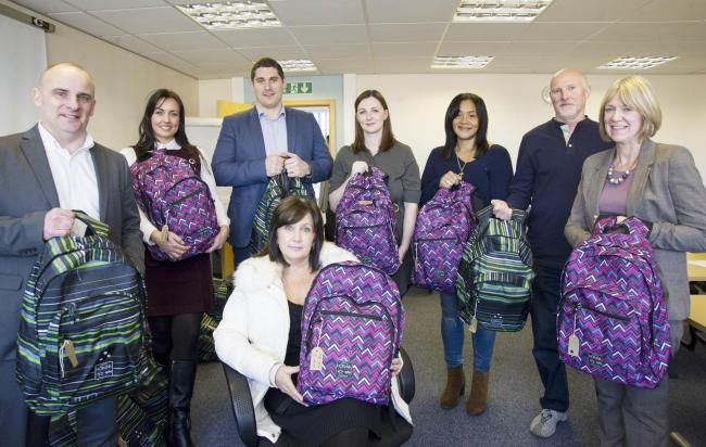 Foster carers will be given comfort bags for the children in their care as part of a joint project with Nationwide, pictured at the Lyndhurst Centre..left 2 right .Pic - Neil Spark, Sian Briddon, Daniel Warren, Michelle Galati- below, Lyndsey Ward, Judy D