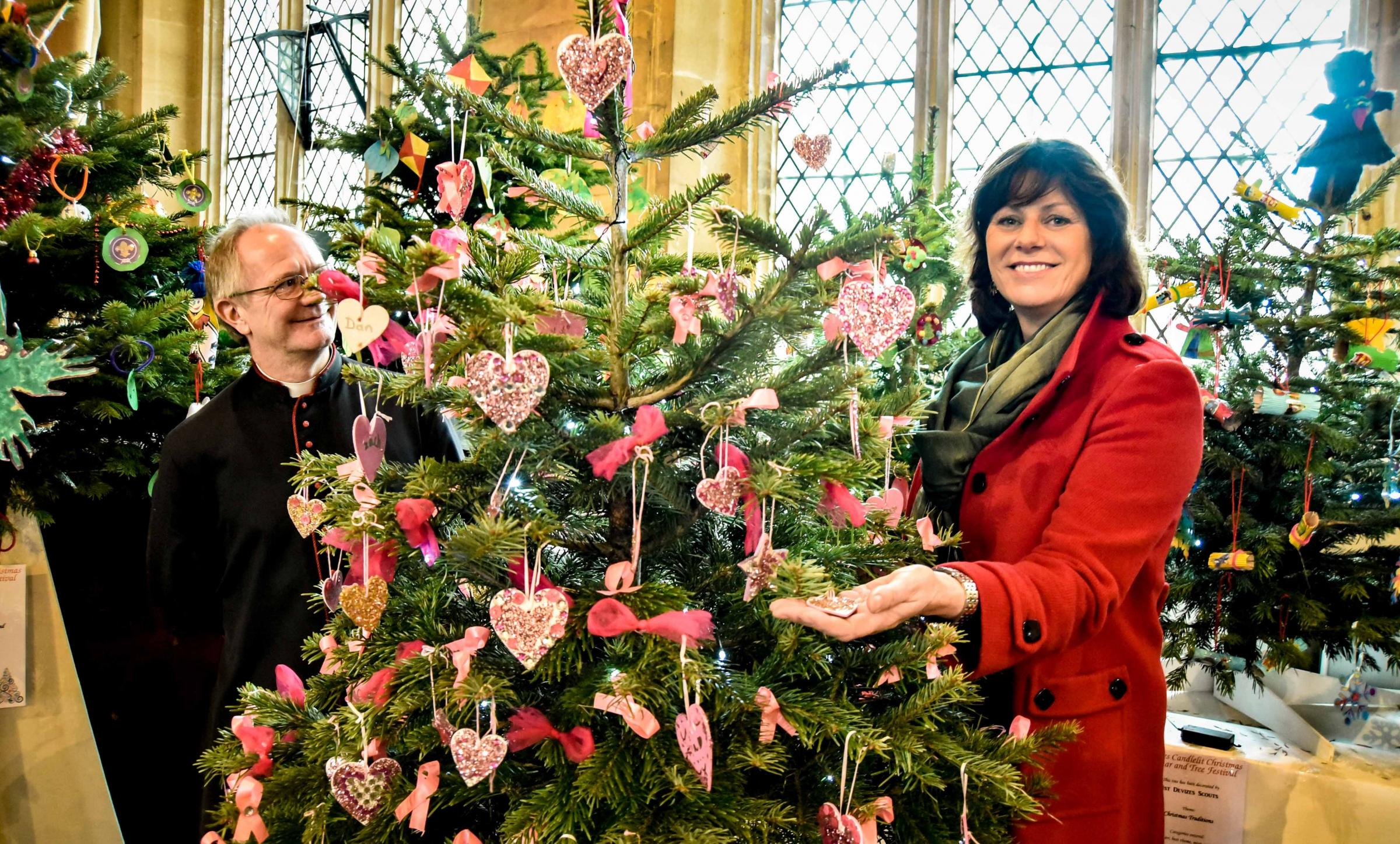 Devizes MP Claire Perry and Rev Canon Paul Richardson with the winning Junior section tree from Rowde Priamry School.  s at St John's Church Christmas tree festival Devizes.Photo www.gphillipsphotography.com  GP1108-8.