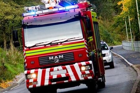 Firefighters stablise house following car crash