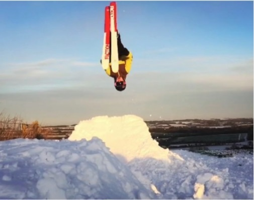 James Richardson perfomring a flip on skies Pic: Matt Snell