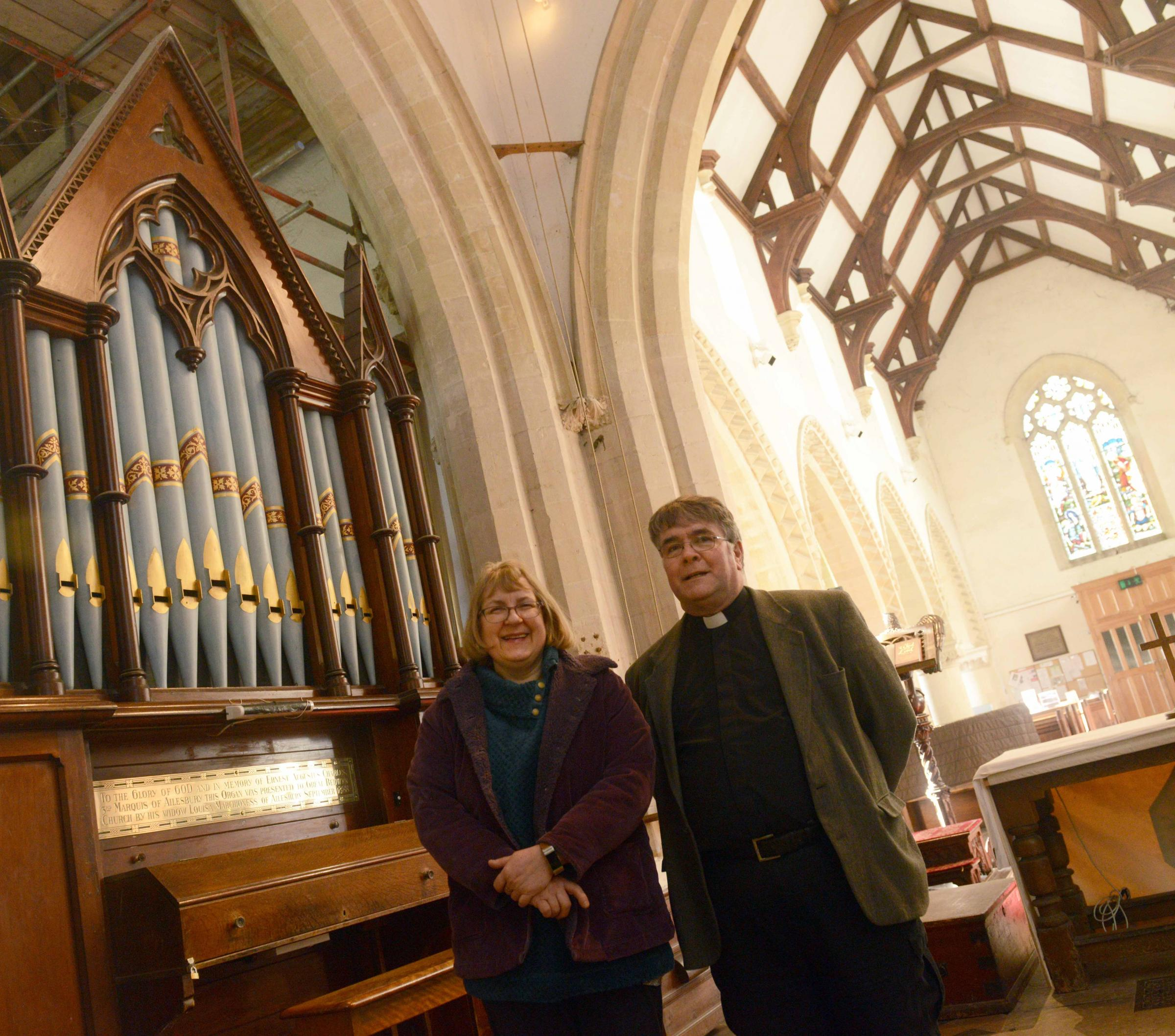 L-r Sue Challen and Rv Michael McHugh with the organ at St Mary's Great Bedwyn.      Photo: Siobhan Boyle SMB2309/2