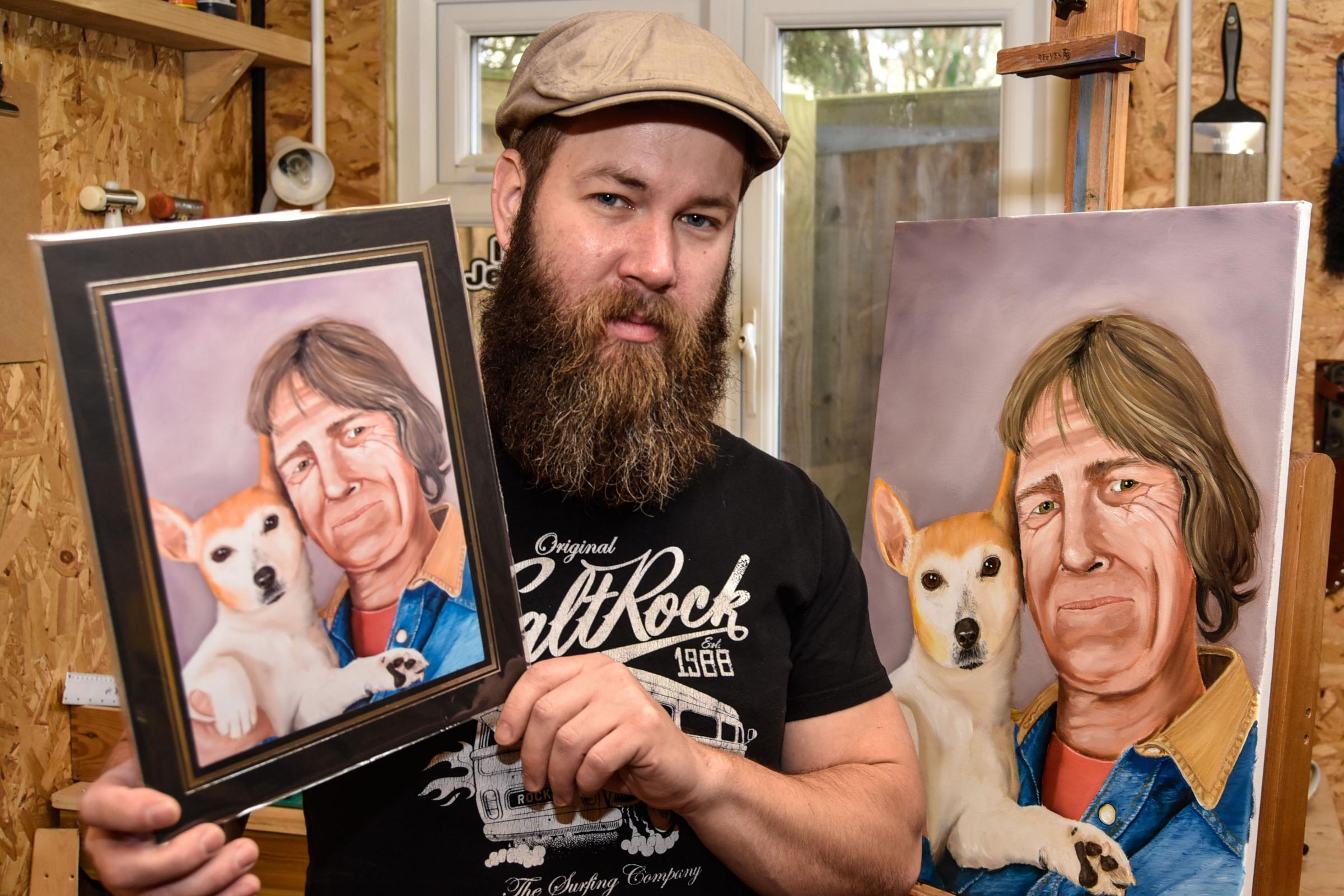 Calne artist Jamie Wilson with the portrait of his late brother Troy and his dog Boots. Photo www.gphillipsphotography.com  GP1149-2