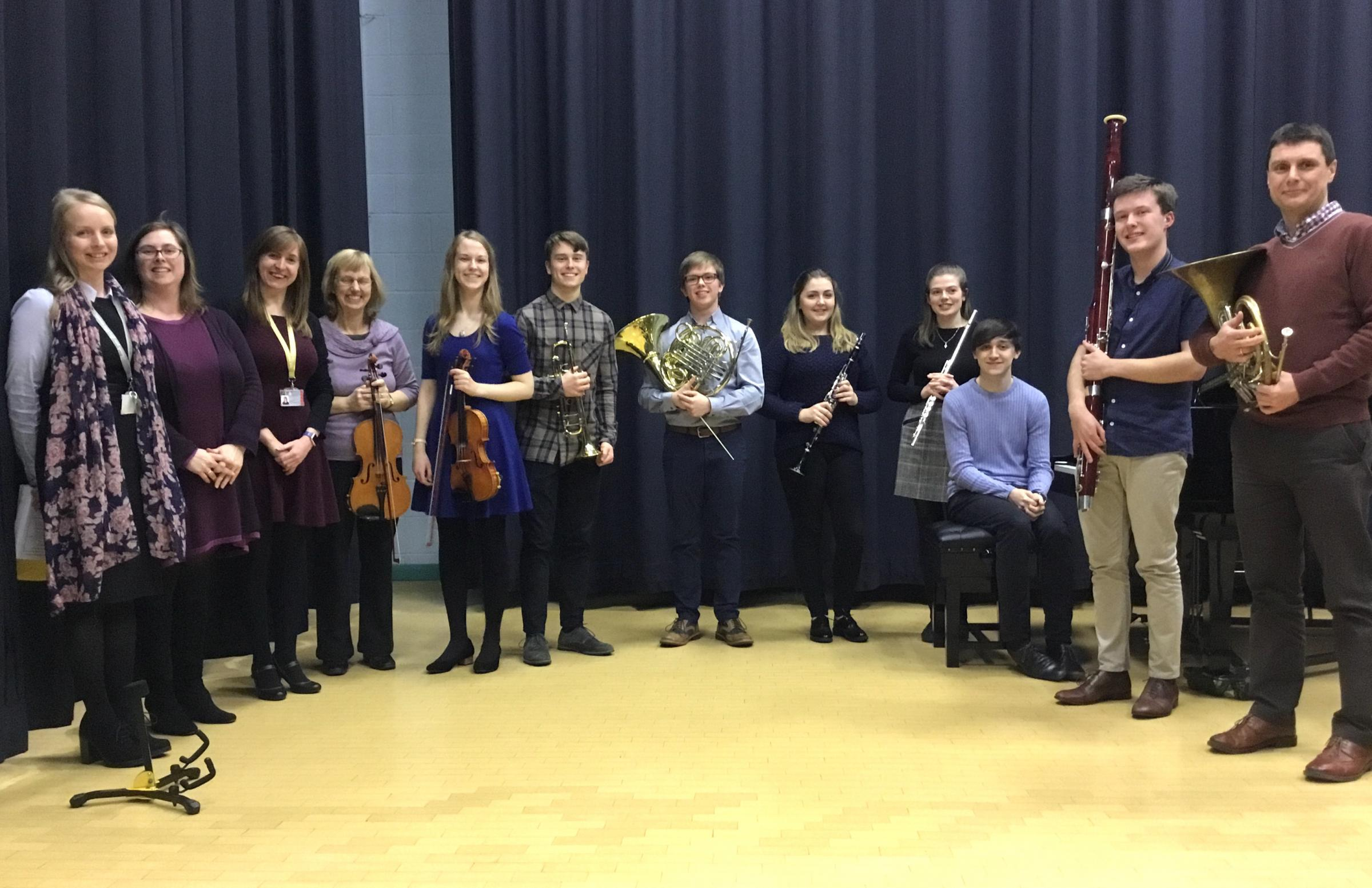 The young musicians with their music teachers