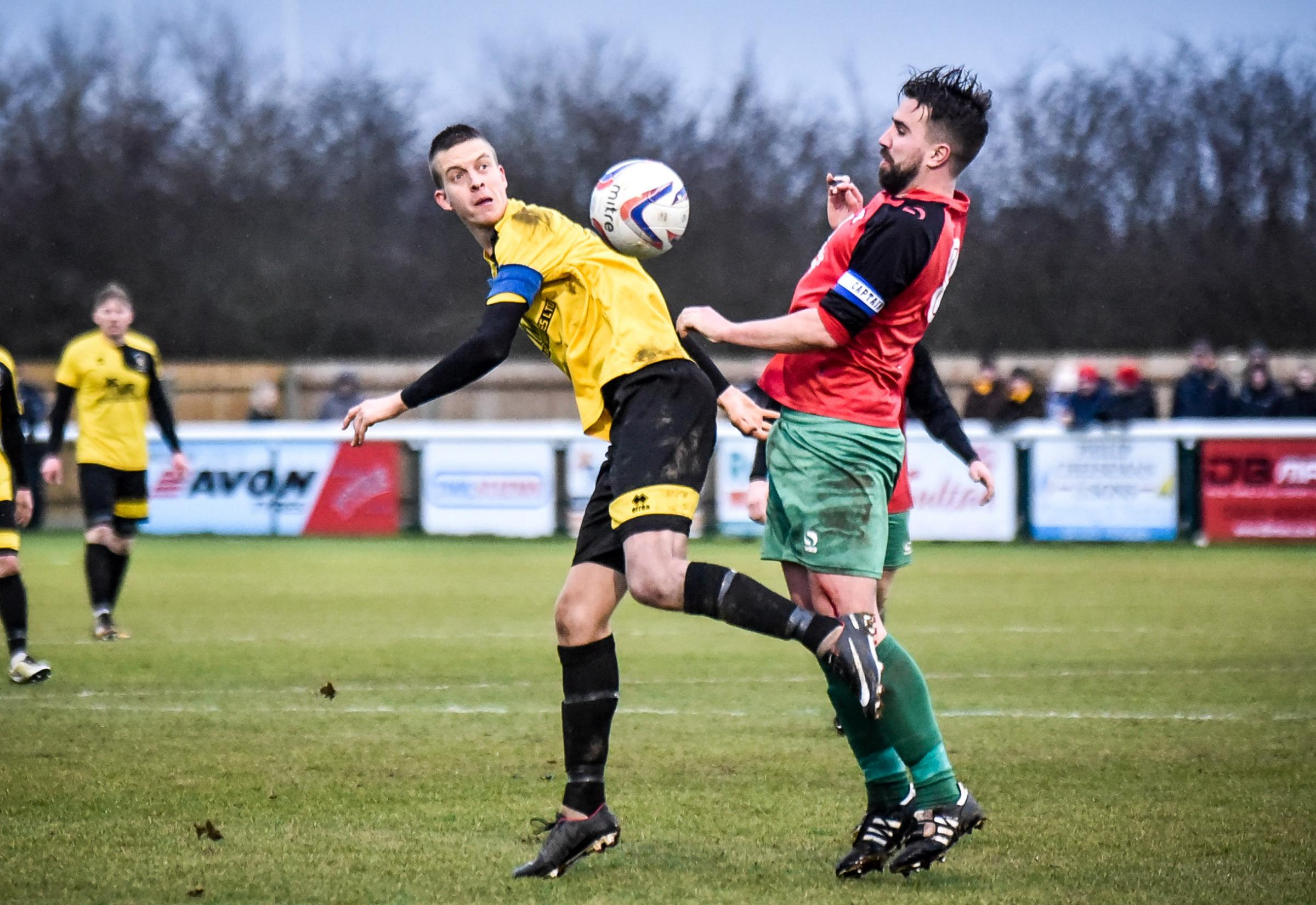 Gary Higdon (left) in action during Melksham's win in the last round of the FA Vase against Tring Athletic