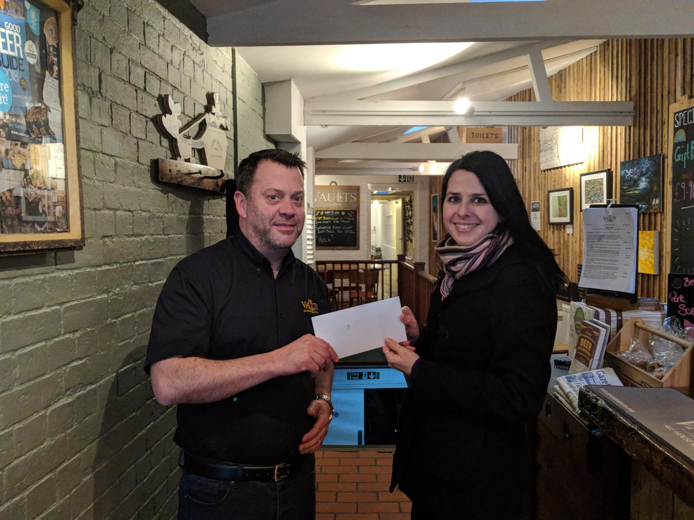 A cheque is handed over for Victim Support Wiltshire
