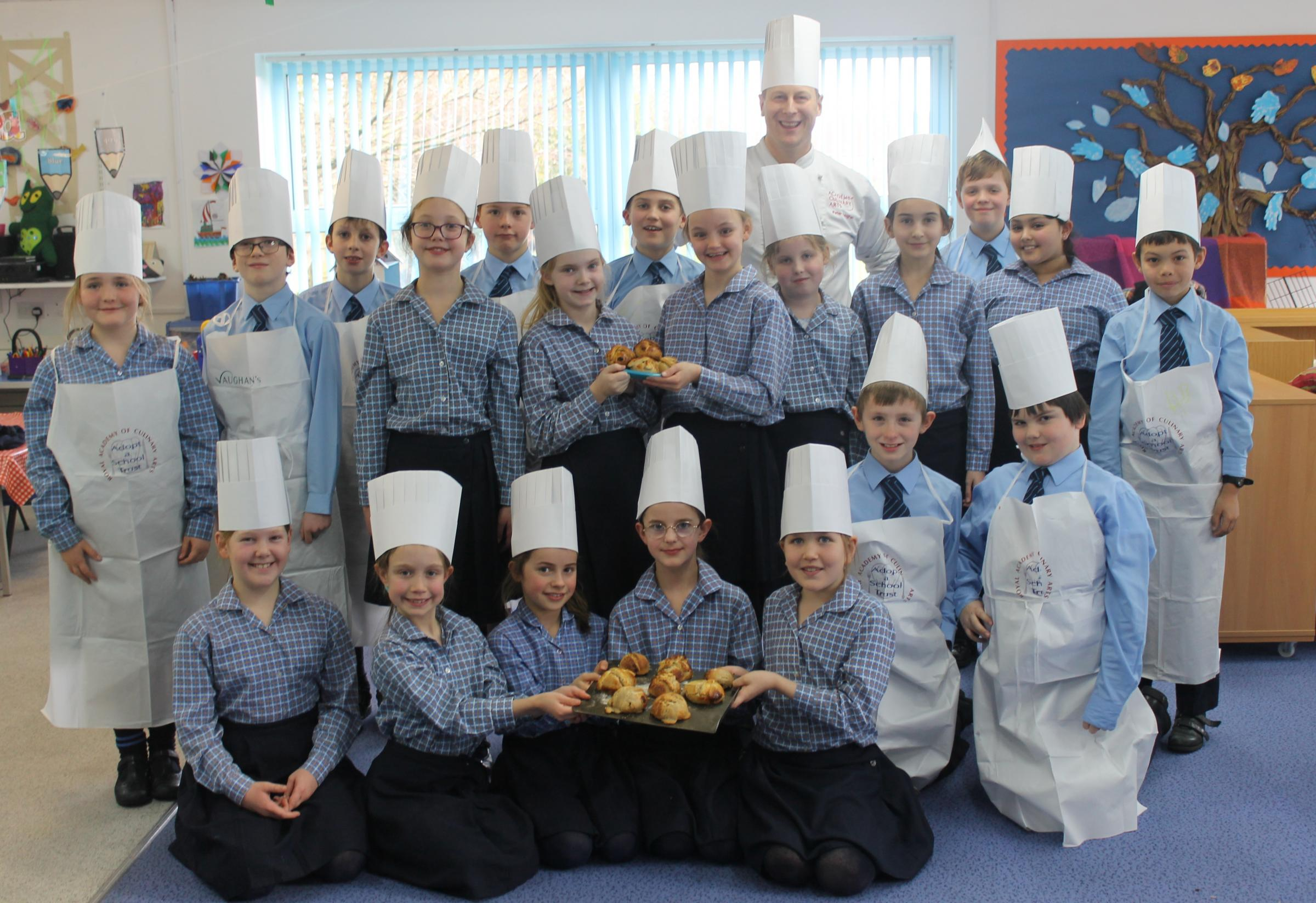 Chef Peter Vaughan teaches pupils at St Margaret's Preparatory School, Calne about bread making
