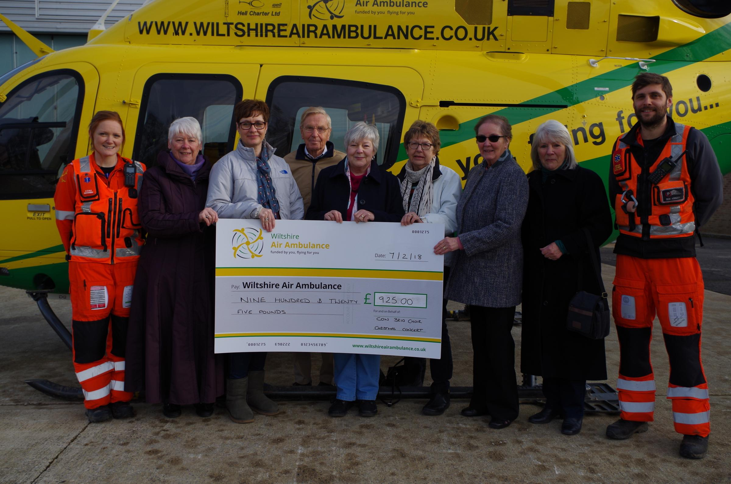Members of Con Brio with Wiltshire Air Ambulance paramedics Sophie Holt and Ben Abbott