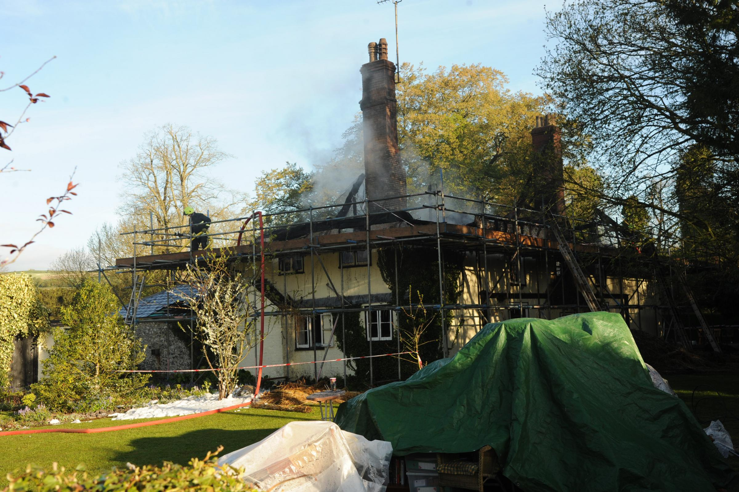 Bishop Cannings Thatch fire. The scene at Bishop Cannings where fire fighters have been dealing with a thatch fire.. Pics Trevor Porter 58465 2.