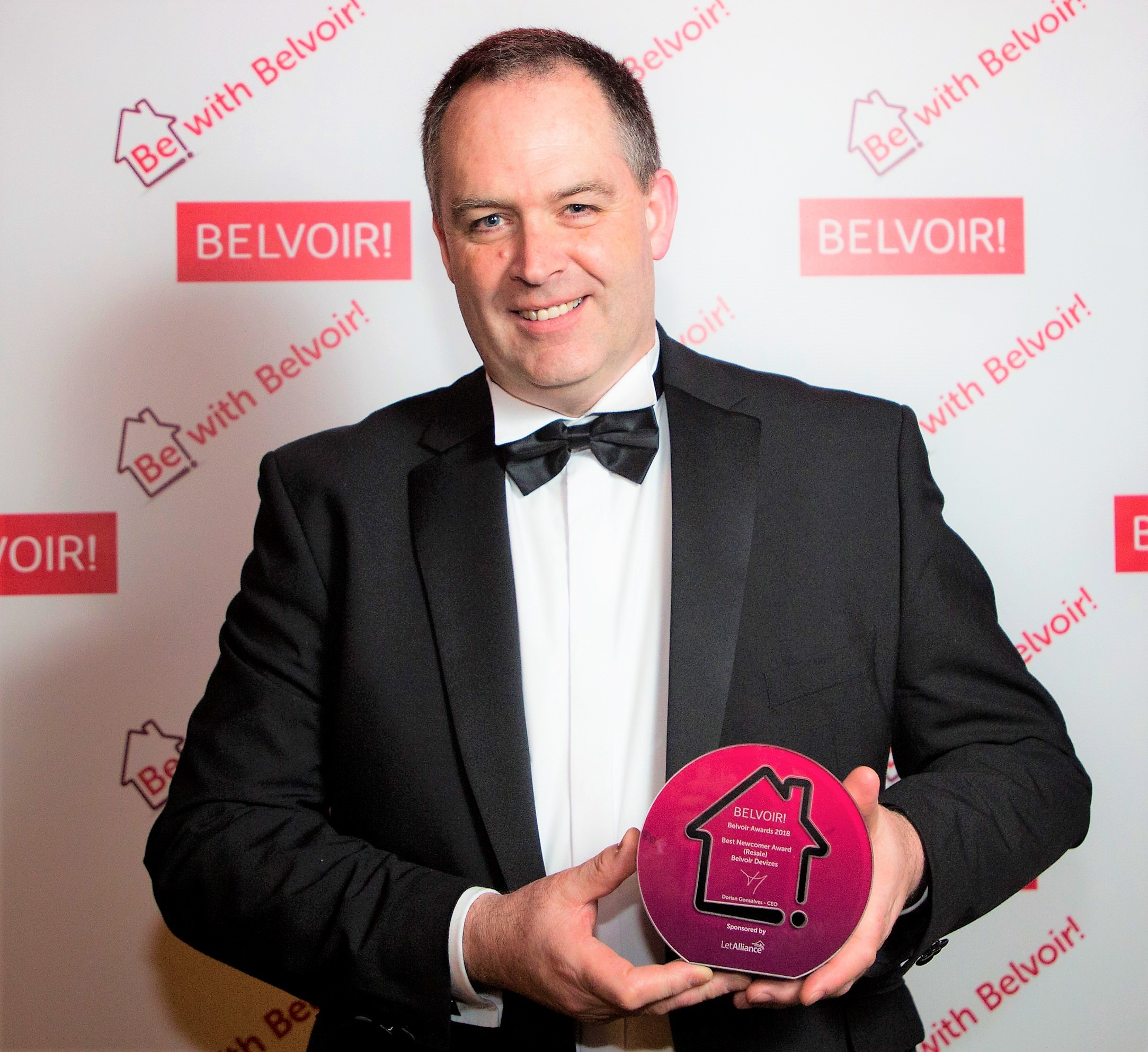 David Devlin, owner of Belvoir franchise in Devizes honours his team and predecessor when receiving the Gold Award.
