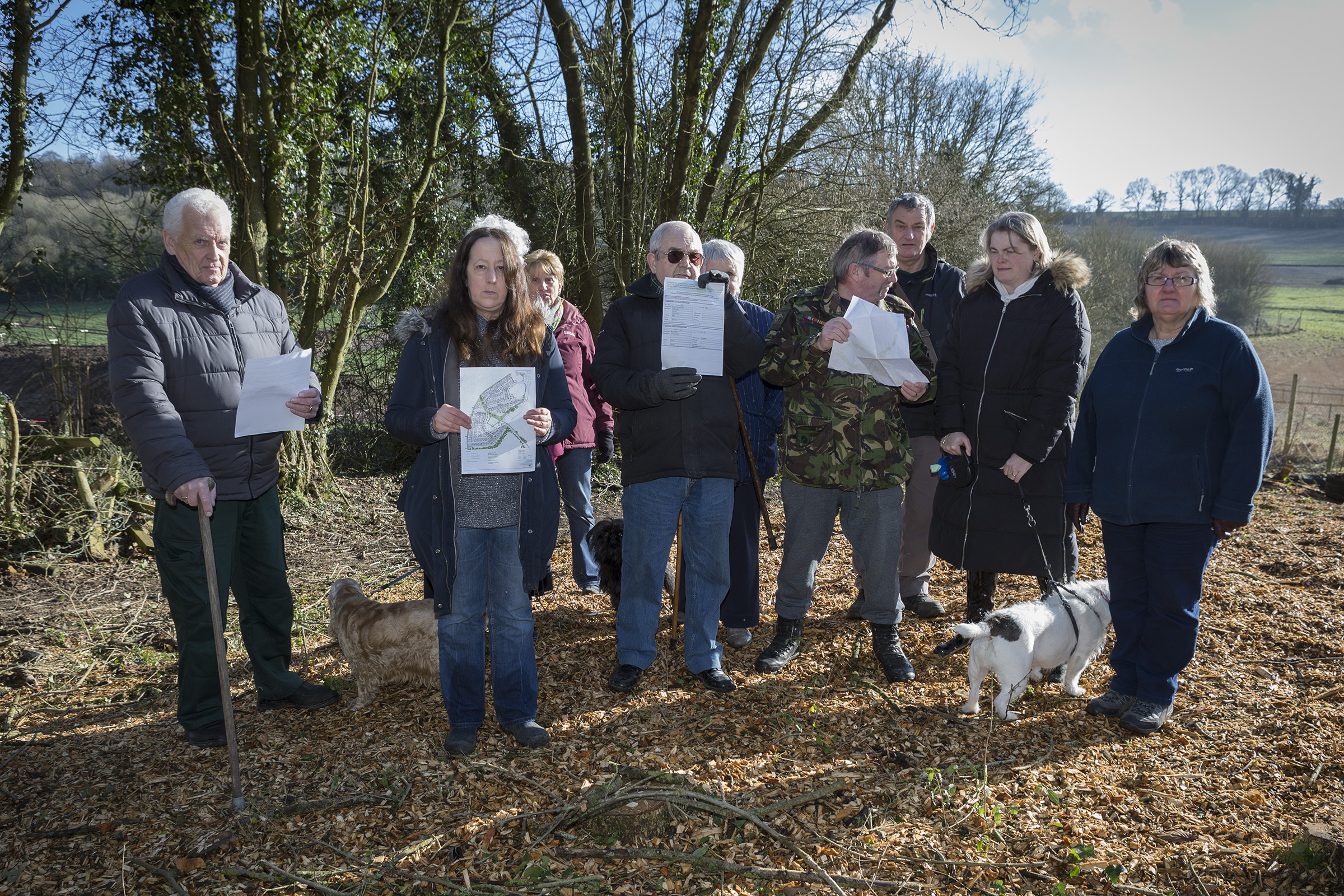 Salisbury Road Development upsetting Orchard Road residents..Pictured: Sara Daw (front left) with Residents holding land boundary maps. They believe Redrow Builders had no right to cut down the wooded area. .Picture: Nicola Salt.30/01/18..
