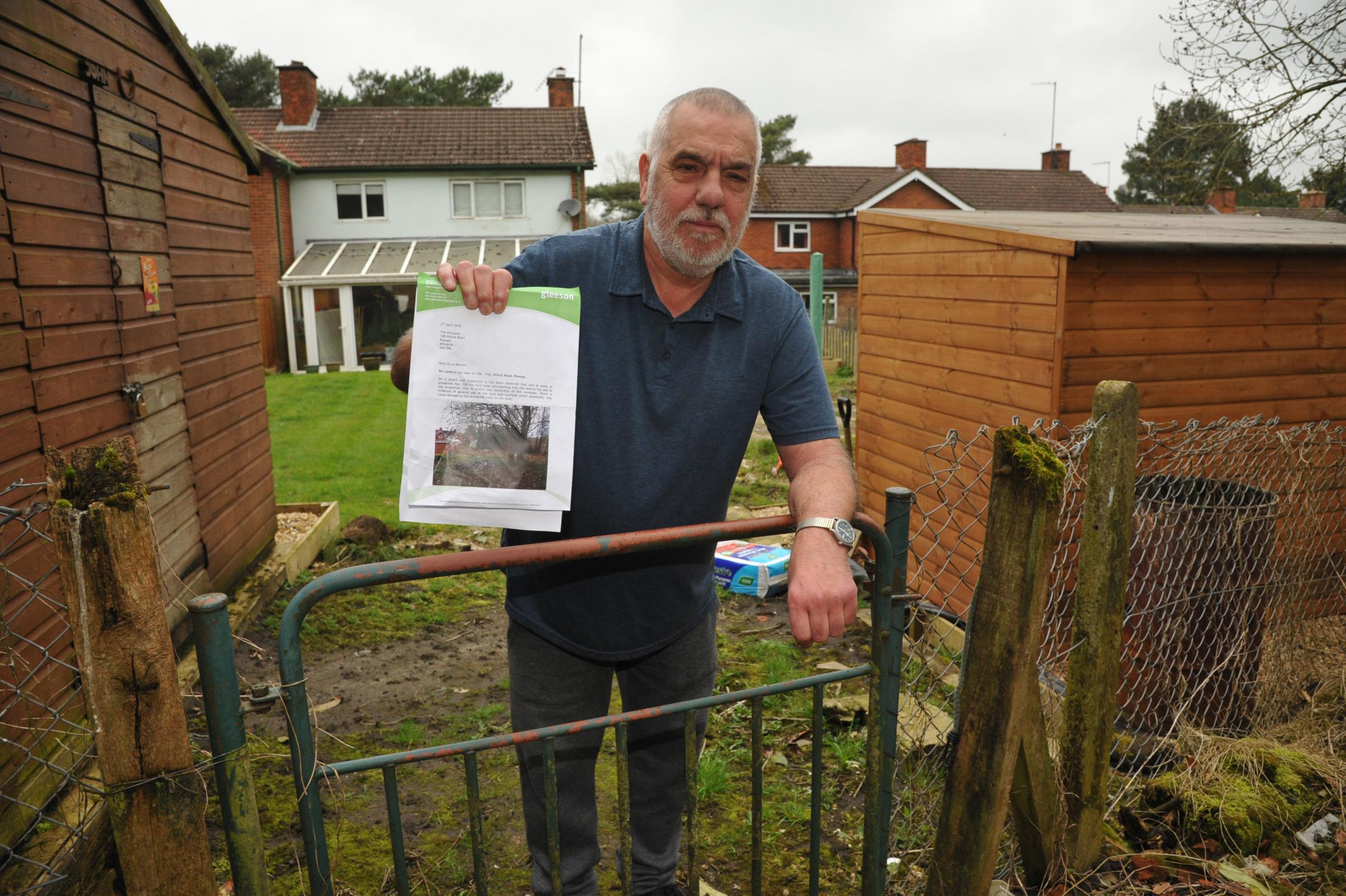 Angry Pewsey resident told to block gate. Angry John Meloret told by developers Glesson he has to block up his back gate.      Photo; Trevor Porter 59495 2..