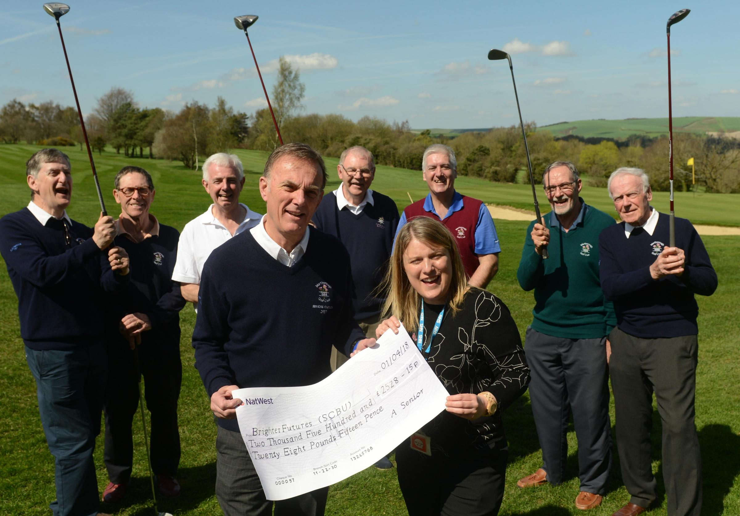 Marlborough golf club present cheque to Brighter Futures. . Photo: Siobhan Boyle SMB2394/3   L-r Garry Bloomfield, Frank Jeffrey, Brian Knox , Rick Bodenham, Geoff North, Henry Pritchard. Front  Mike Paines, Lisa Utting (Brighter Futures),