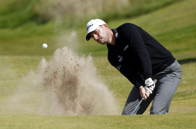 England's David Howell chips out of the bunker on the 14th during day four of the Saltire Energy Paul Lawrie Match Play at Murcar Links Golf Club, Aberdeen. PRESS ASSOCIATION Photo. Picture date: Sunday August 2, 2015. See PA story GOLF Murcar. Photo
