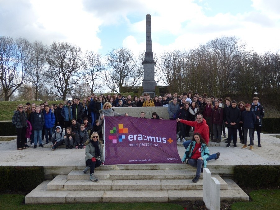 Pupils and staff from Hardenhuish School and Sintermeeten College flying the Erasmus flag at the Martgarten American Cemetery in The Netherlands.