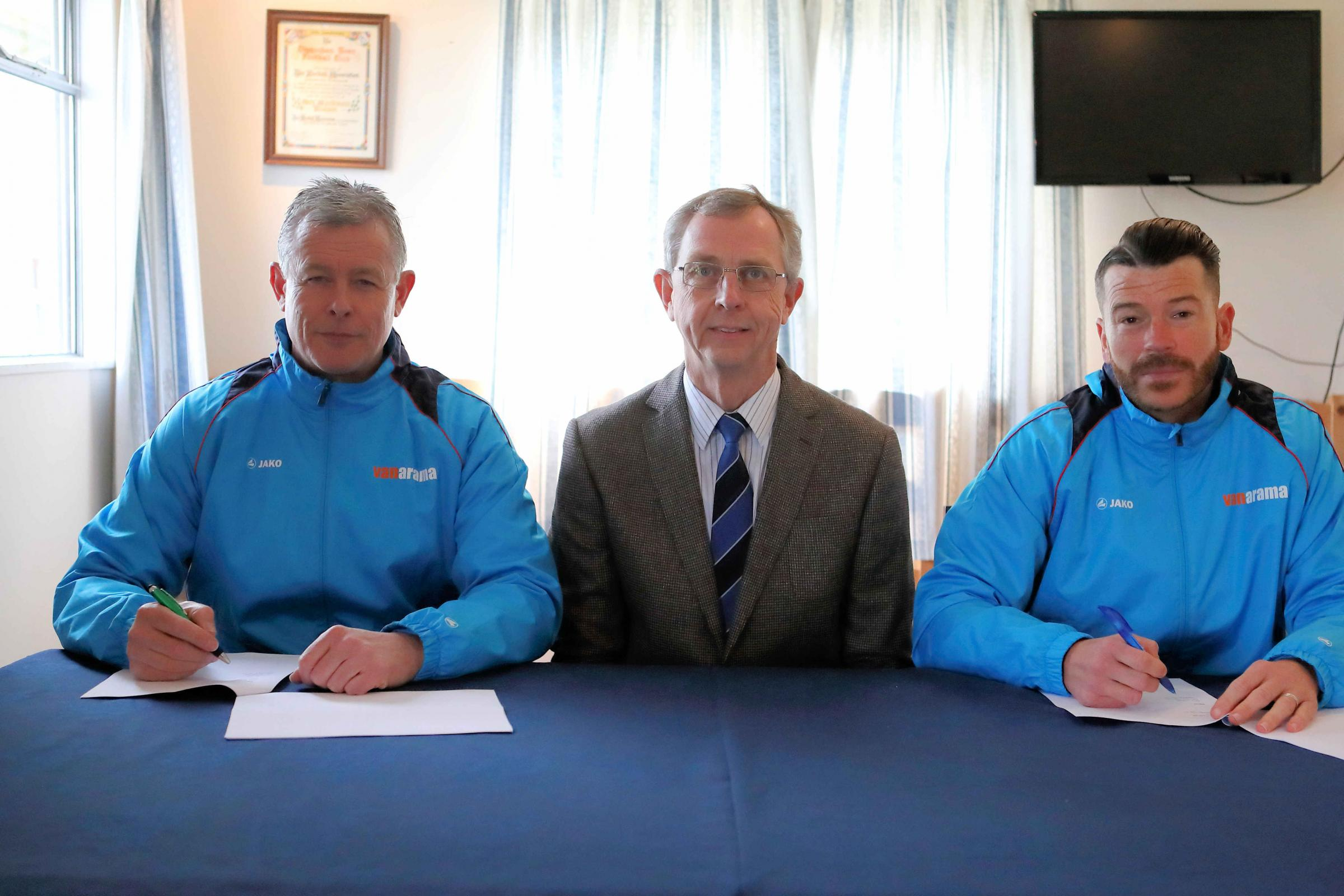 Mark Collier (left) and Gary Horgan agree new contracts at Chippenham Park, watched by chairman Neil Blackmore (centre). PICTURE: RICHARD CHAPPELL
