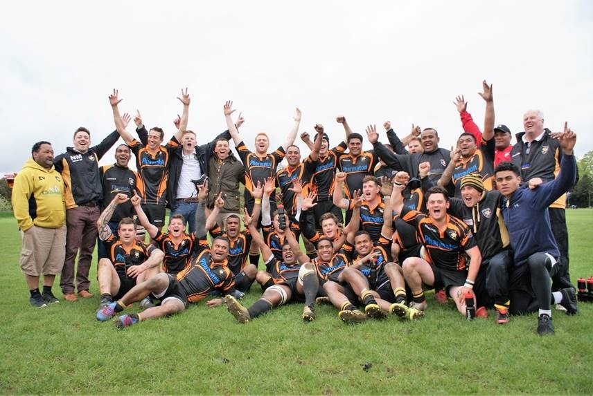 Marlborough's players and management celebrate their stunning victory at Windsor that secured them promotion to South West level for the first time