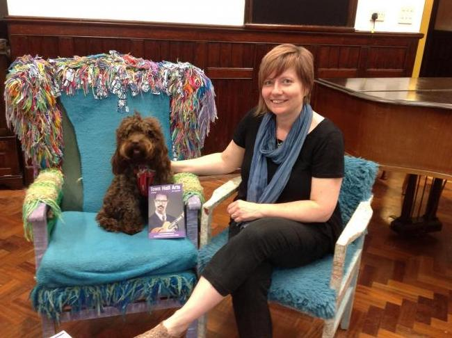 Widget the Cockapoo with Town Hall Arts manager Philippa Edwards together on bring your dog to work day