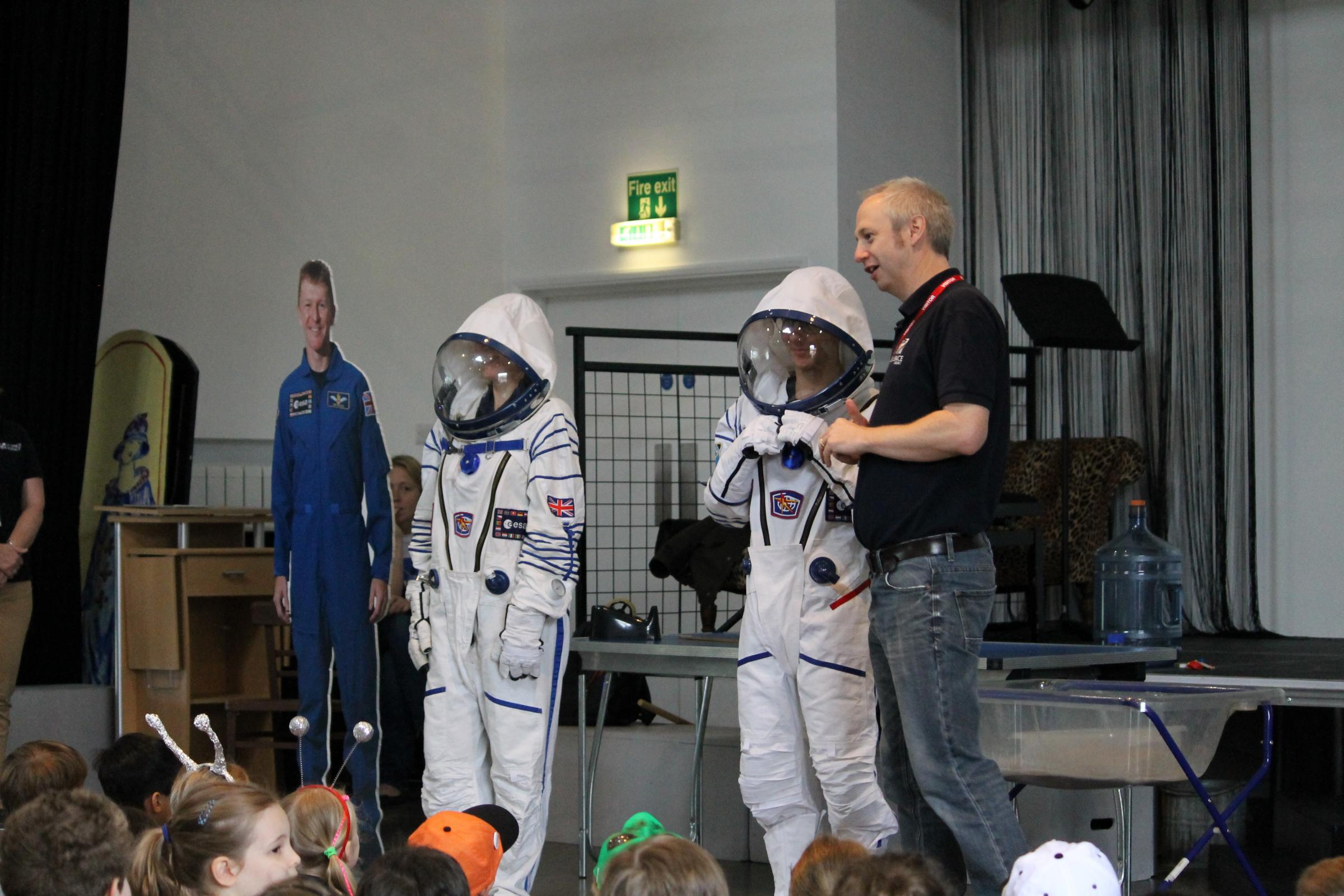 Children at St Margaret's try out space suits