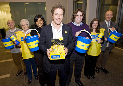 Hugh Grant with Marie Curie volunteers