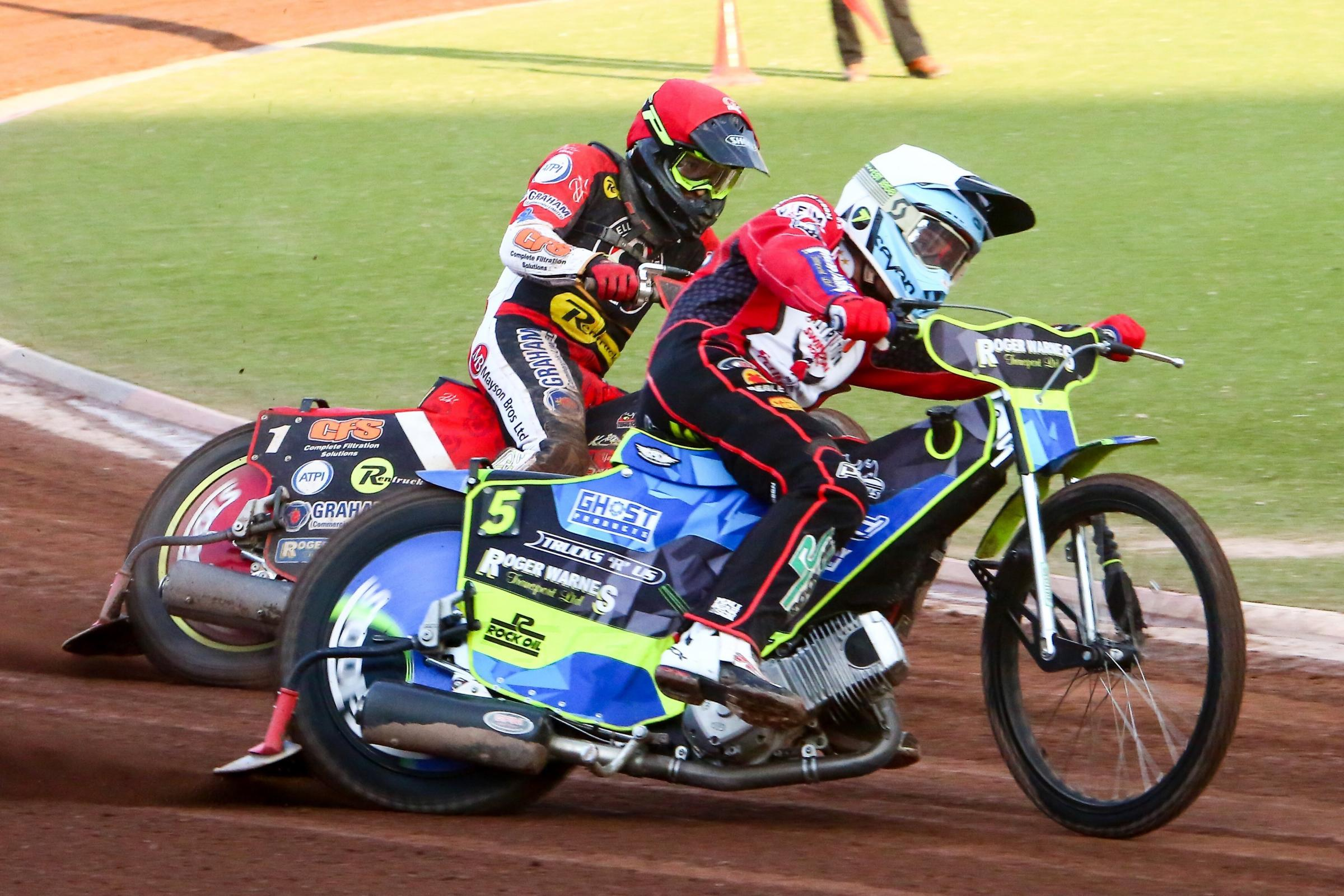 Swindon Robins' Troy Batchelor and Belle Vue's Craig Cook in heat six. Picture: LES AUBREY.